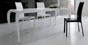 White tables with blackand white chairs around